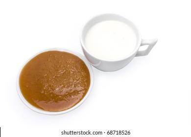 isolated honey and milk on a white background