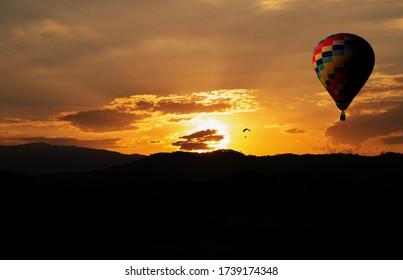 Isolated hotair balloon in sunset sky