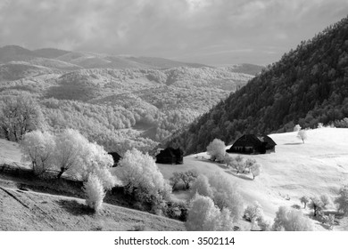 Isolated house on the base of the mountains - infra-red view