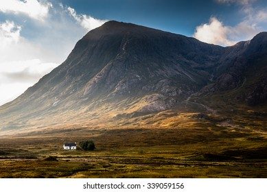 Isolated house surrounded by mountains in the Scottish Highlands