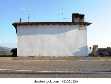 Isolated house with white empty wall. Useful as signboard.