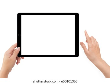 Isolated human left hand holding black tablet computer white screen mockup on white background