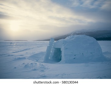 Isolated igloo on a lake in winter before sunset in Yukon. Canada