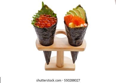 Isolated Ikura (Salmon Roe) and Kani with Avocado, Tamago Yaki (Japanese Fried Egg) and Ebiko (Prawn Egg) California or Temaki Sushi Hand Roll on Wood Stand.