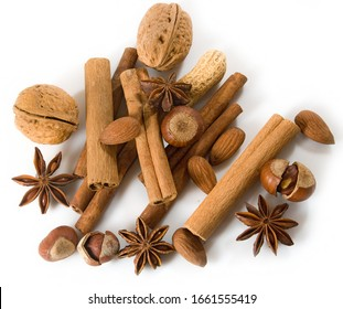 isolated image of anise, walnuts, cinnamon sticks on white background close-up