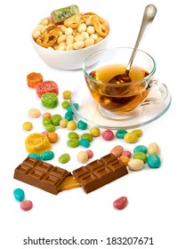 isolated image of a cup of tea and candy closeup