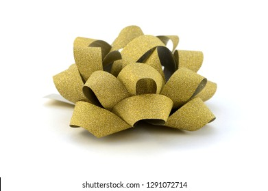 An isolated image of a gold bow for decorating gifts.