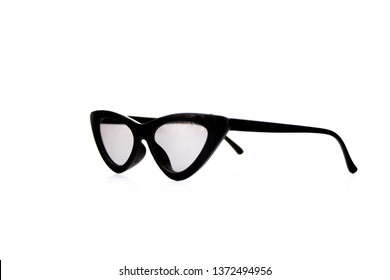 Isolated image of horn-rimmed sunglasses with black frame. Side view.