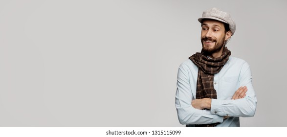 Isolated image, place for copy left. Looking here adult successful confident professional creative person. Clever smart hipster guy, stylish and modern. Writer or painter having creative project.
