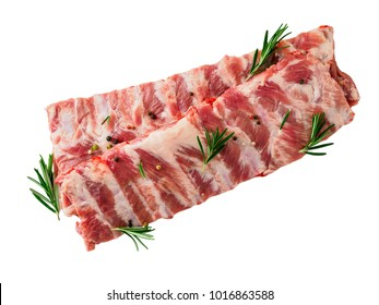 Isolated image of raw pork ribs with seasoning  rosemary, pepper on white background, top view