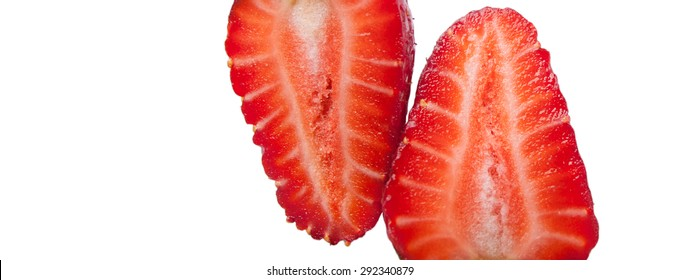 Isolated image of a ripe red strawberry cut in half on a white background