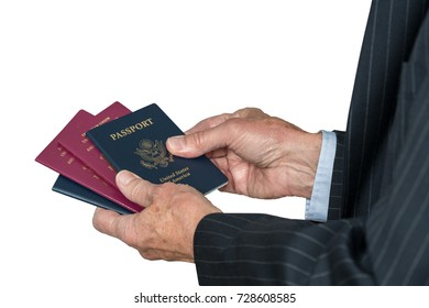Isolated image of a senior man arm in suit choosing which passport to use