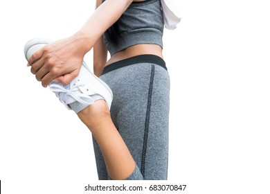 Isolated image of sport woman doing leg stretching, warming up, isolated on white background. Concept of woman running, women fitness.