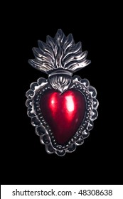 Isolated image of a stamped sacred heart medallion