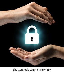 Isolated image of two hands on black background. Lock icon in the center, as a symbol of confidentiality, data protection and security. Concept of confidentiality, data protection and security.