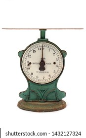 Isolated image of well worn antique green kitchen scales on a white background