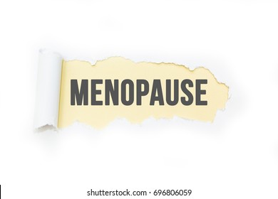 "Isolated inscription ""menopause"" on a yellow background, tearing paper."