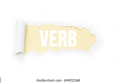 """Isolated inscription """"verb"""" on a yellow background, tearing paper."""