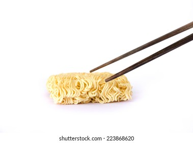 isolated instant noodle and chopsticks