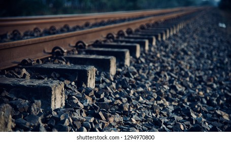 Isolated iron made railway tracks with stones photo