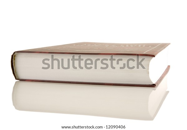 Isolated large closed book on a white background, selective focus