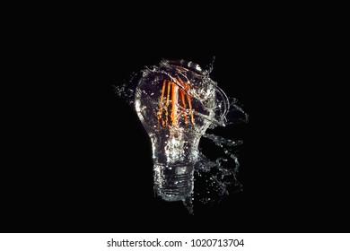 Isolated Led Light Water Splash on black background.