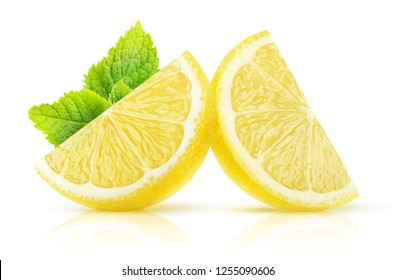 Isolated lemon wedges. Two pieces of lemon fruit with mint isolated on white background with clipping path