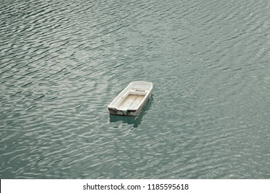 Isolated little boat on the lake - Aerial view - Marche, Italy, Europe