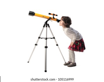Isolated little girl looking into a telescope