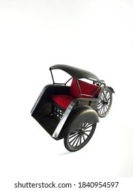 An Isolated Local Indonesian Transportation Mini Figure with White Background. An Indonesian Becak with Red Cushion Seat