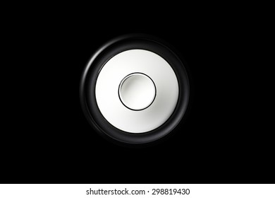 Isolated loudspeaker driver with black background.