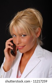 Isolated lovely and sexy young blond girl talking on a telephone