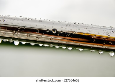 Isolated macro steel pipe covered with raindrops