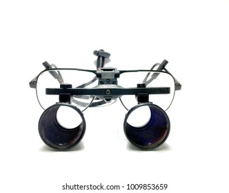 isolated of magnifying surgical loupes with glasses for vascular or micro surgery .