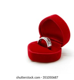 isolated male diamond ring in red valvet box