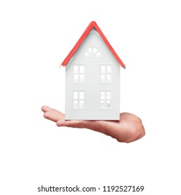 isolated male hand with a house model