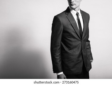 Isolated man it a suit.
