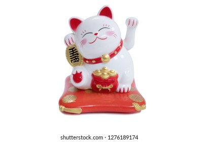 Isolated Maneki Neko Cat a Symbol of luck and wealth in Asian Culture