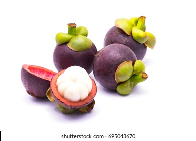 Isolated mangosteens. Three whole fruits and one half isolated on white background with clipping path