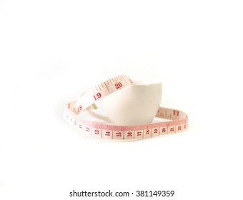 Isolated measure tape in the white cup