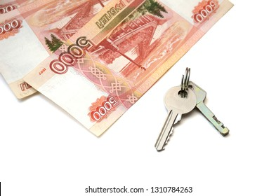 Isolated metal keys and a bunch of banknotes of five thousand Russian rubles. Concept of buying an apartment, flat or house, mortgage, rental housing, housewarming, home expense