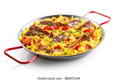 Isolated metal pan full of yellow rice, spare ribs and bell pepper slices of white background