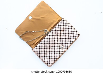 Isolated metallic gold evening bag woman fashion accessory on white background