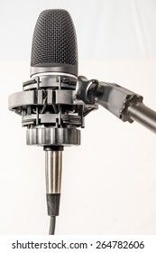 Isolated Microphone in cradle against white background
