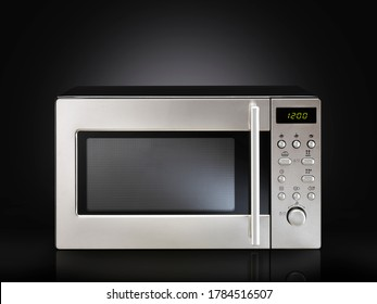 Isolated microwave on black background.