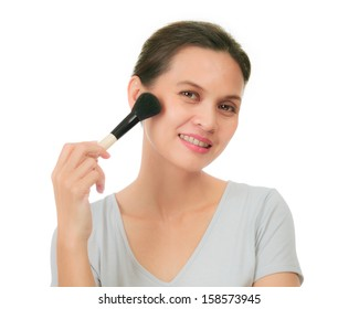 Isolated middle age asian woman with make up brush.