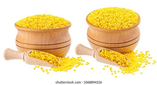 Isolated millet seeds. Wooden bowl and scoop with millet groats on white background. Close-up