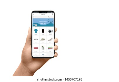 Isolated modern smartphone in woman hand with flat design online store app with product categories and grab deals banner.