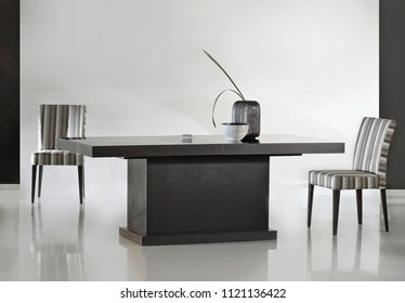 Isolated modern wooden dining table with chairs