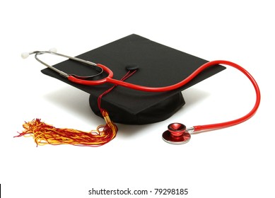 An isolated mortarboard and stethoscope to conceptualize the medical graduate.